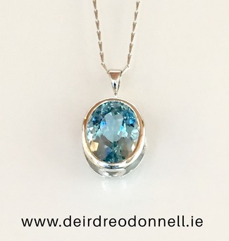 10_carat_gold_with_swiss_blue_topaz_pendant